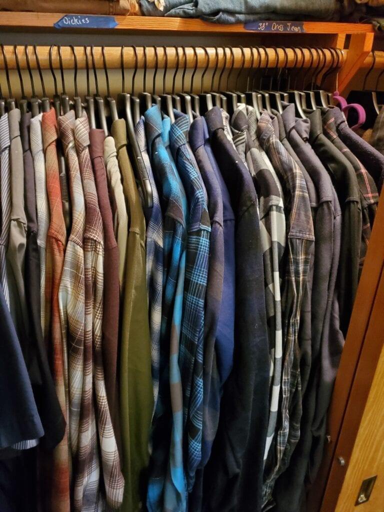 picture of closet full of dixxon flannels hung on black clothes hanger