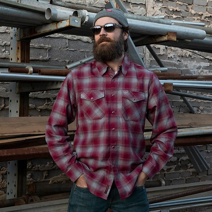 man wearing dixxon pinot flannel shirt standing