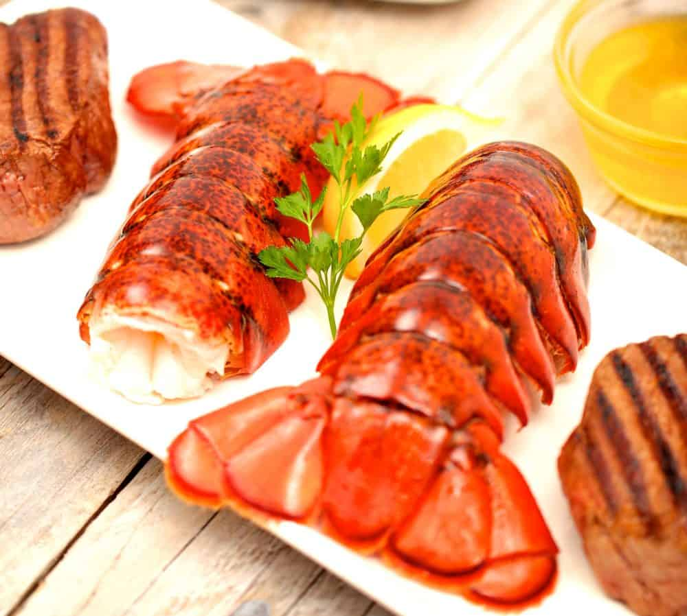 cooked lobster tail with garnish
