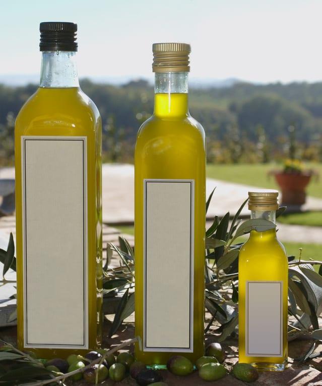 three bottles of olive oil in sun